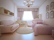 Dormitorio de los adolescentes con el sofá y la cama Foto de archivo libre de regalías