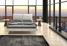 Dormitorio del diseño moderno con la opinión del paisaje foto de archivo libre de regalías
