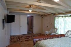 Dormitorio interior de la cabaña Foto de archivo libre de regalías