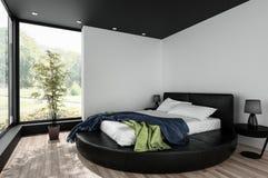 Dormitorio minimalista con la cama matrimonial redonda Fotografía de archivo