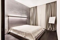 Dormitorio moderno del estilo del minimalism foto de archivo