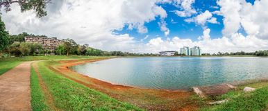 The dormitory around the reservoir in Prince of Songkla University, Hat Yai, Thailand. During the day with blue sky and waves on the water Stock Photo