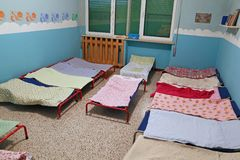 Dormitory with beds for children in the early childhood school Royalty Free Stock Image