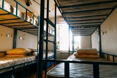 Dormitory room with bunk beds in new hostel for students or travelers. stock photo