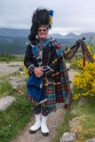 Senior bagpipe player in full tradition dress, Scotland. Stock Image