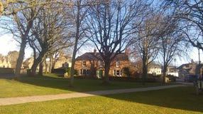 Dornochhuis en bomen Royalty-vrije Stock Afbeelding