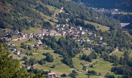 Dorp in Alpen Stock Foto