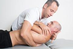 dorsal manipulation Stock Photos