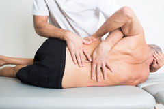Dorsal manipulation Stock Photography