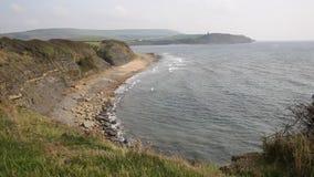 Dorset coast Kimmeridge Bay east of Lulworth Cove uk towards Clavell Tower stock footage