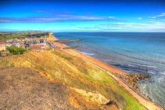 Dorset coastline West Bay uk Jurassic coast in colourful HDR Stock Photo