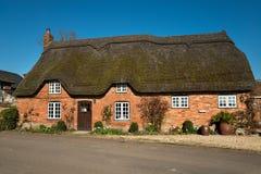 Dorset a couvert le cottage de chaume image libre de droits