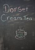 Dorset cream tea sign. Dorset cream tea chalkboard with a teacup image, Weymouth, Dorset, England, UK, Western Europe Stock Photos