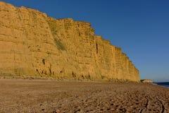 Dorset falezy, zmierzch na plaży, morze i niebo, Zdjęcie Royalty Free