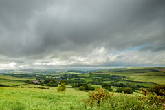Dorset landscape. Dark clouds rolling in over the farmland of Dorset in the UK stock photos