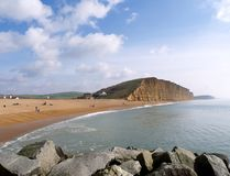 Dorset Landscape, West Bay Beach, Bridport. Dorset Coast in England - West Bay. part of the Jurassic Coast and the views across the bay with the orange coloured royalty free stock photography