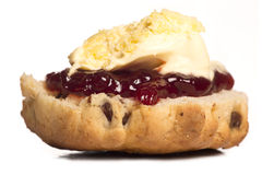 Dorset scone with clotted cream on top Stock Photography