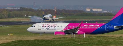 Ryanair and wizz air airplane starting at dortmund 21 airport germany royalty free stock photography