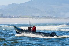 Dory Boat Coming In At Cape Kiwanda Royalty Free Stock Images