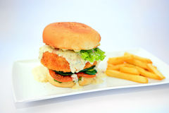 Dory burger with potato chips Stock Photo