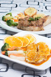 Dory fish steak with orange sauce Stock Photography