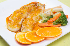 Dory fish steak with orange sauce Stock Image