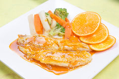 Dory fish steak with orange sauce Royalty Free Stock Image