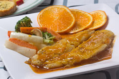 Dory fish steak with orange sauce Royalty Free Stock Images