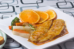 Dory fish steak with orange sauce Royalty Free Stock Photography