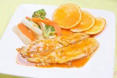 Dory fish steak with orange sauce Royalty Free Stock Photo