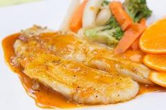 Dory fish steak with orange sauce Stock Image