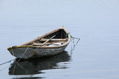 Dory. Small wooden dory in the ocean Stock Photo