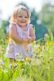 Dos-años de niño en el prado Imágenes de archivo libres de regalías
