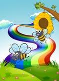 Dos abejas en la cumbre y un arco iris en el cielo stock de ilustración