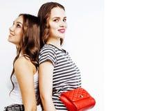 Dos adolescentes de los mejores amigos junto que se divierten, presentando emoti Foto de archivo