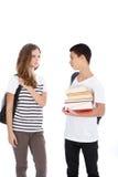 Dos adolescentes en hablar blanco del fondo Fotografía de archivo libre de regalías