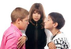 Dos adolescentes enojados y la muchacha Fotografía de archivo libre de regalías