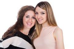 Dos amigos femeninos aislados Imagen de archivo
