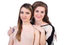 Dos amigos femeninos aislados Foto de archivo libre de regalías