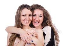 Dos amigos femeninos aislados Fotos de archivo libres de regalías