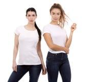Dos amigos femeninos en el fondo blanco Imagen de archivo libre de regalías