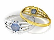 Dos anillos con la gema azul Fotografía de archivo