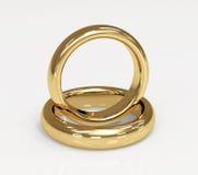 Dos anillos de bodas del oro 3d Imagenes de archivo