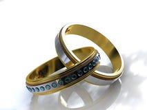 Dos anillos de compromiso del topaz del oro del tono Imagen de archivo