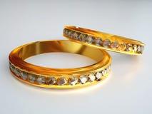 Dos anillos de diamante del oro Imagenes de archivo