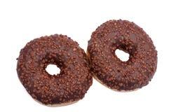 Dos anillos de espuma del chocolate con asperjan Aislado en un fondo blanco Imagenes de archivo