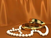 Dos anillos de oro en la seda roja stock de ilustración