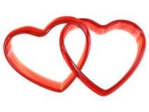 Dos anillos en forma de corazón Fotos de archivo libres de regalías