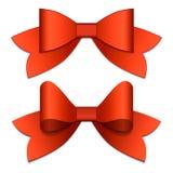 Dos arcos rojos con las cintas rojas Imagen de archivo libre de regalías