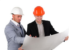 Dos arquitectos que se divierten que discute un plan Imagen de archivo libre de regalías